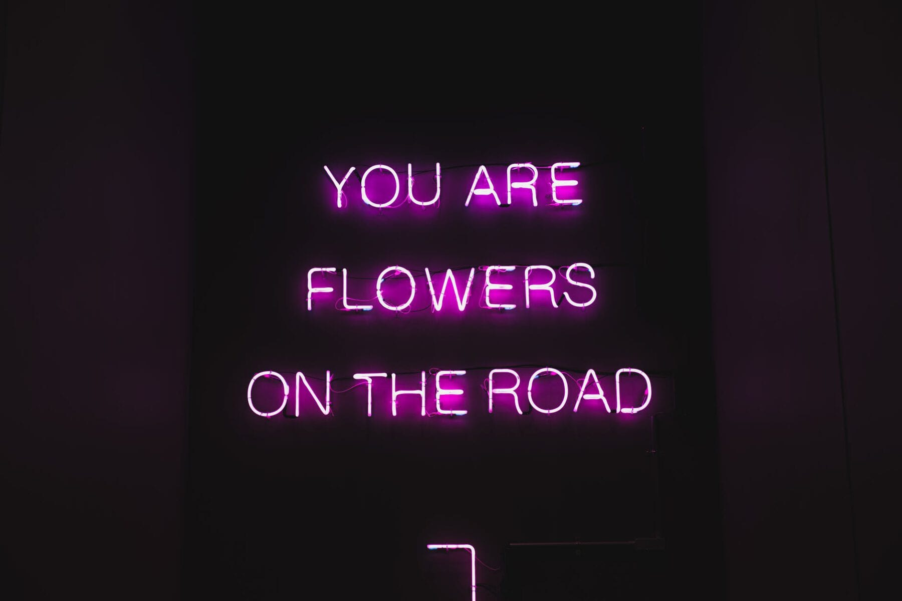 black billboard with pink text