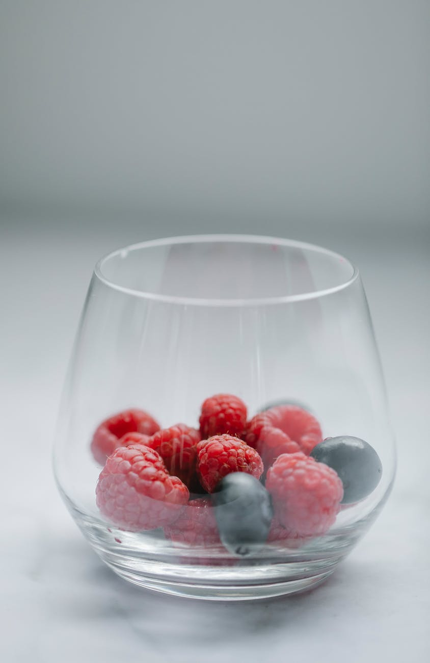 glass of fresh berries on table