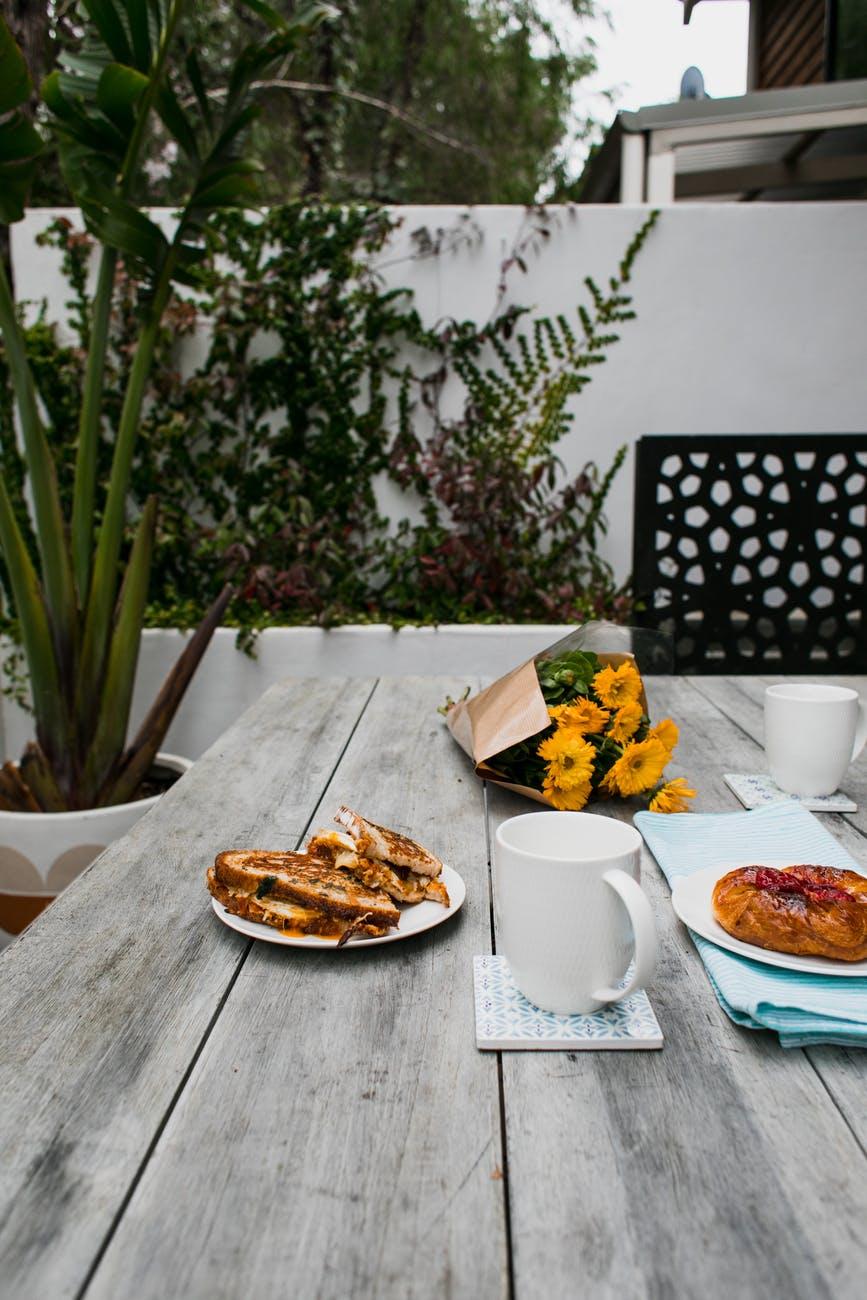 appetizing breakfast served outdoors on terrace